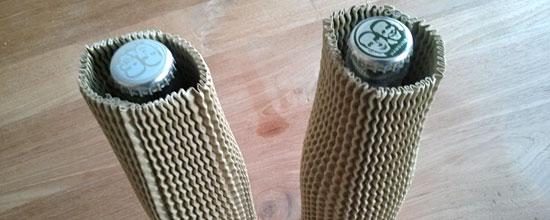 Flaschen sind mit Kartonschutz gepolstert. Leider nicht alle