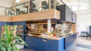 """Erst essen gehen, dann einkaufen: Konsum Dresden kombiniert für """"Genusskultur Konsum"""" Gastronomie und Mini-Markt"""